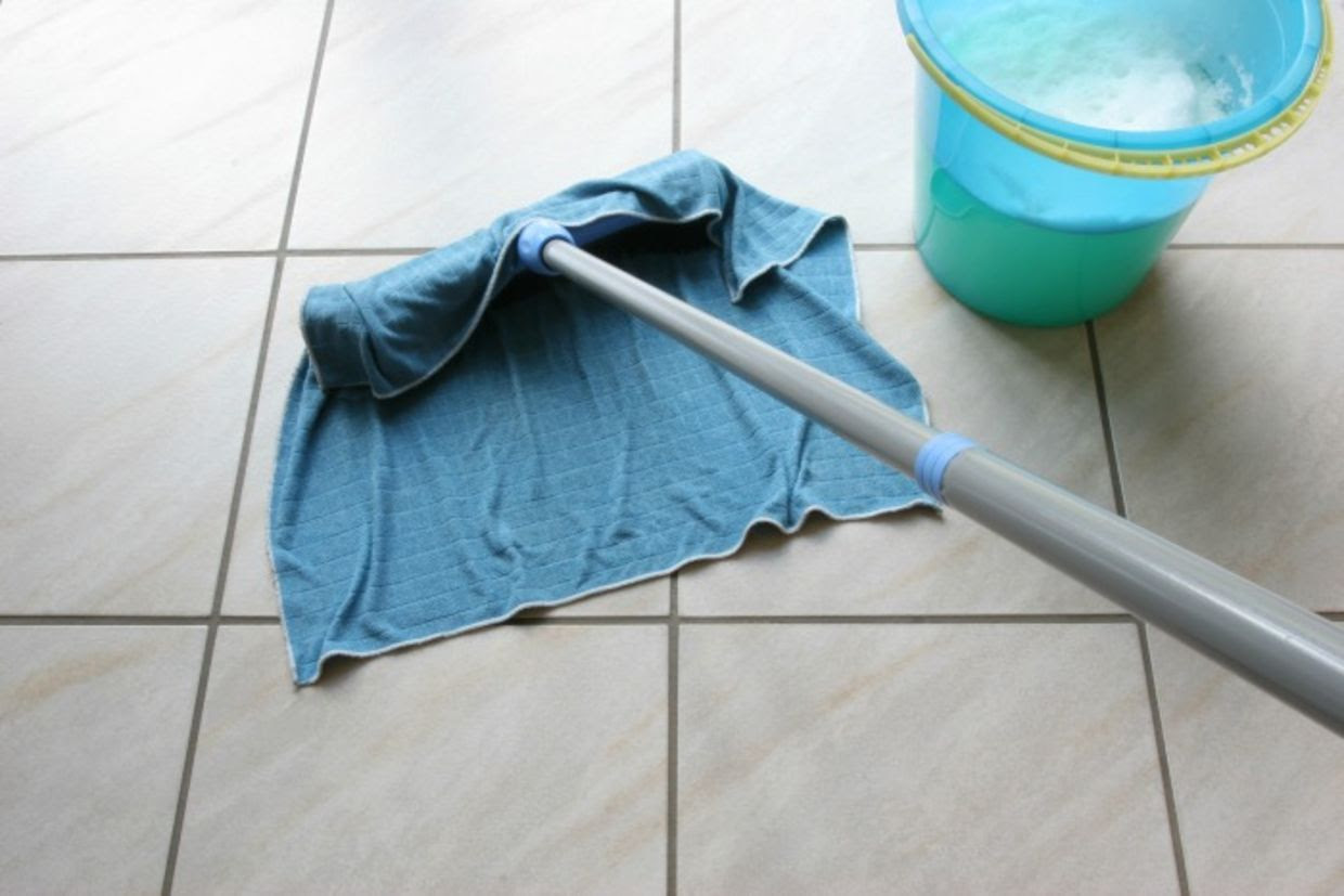 Cleaning floor with rag