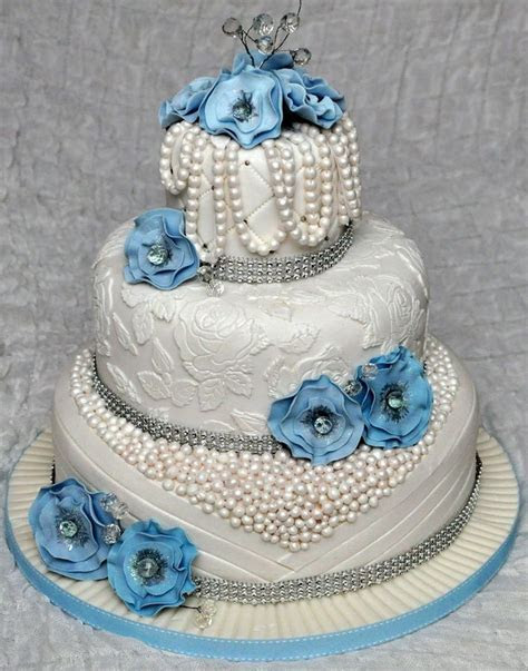 3 tier wedding cake with edible pearls and lace. Decorated