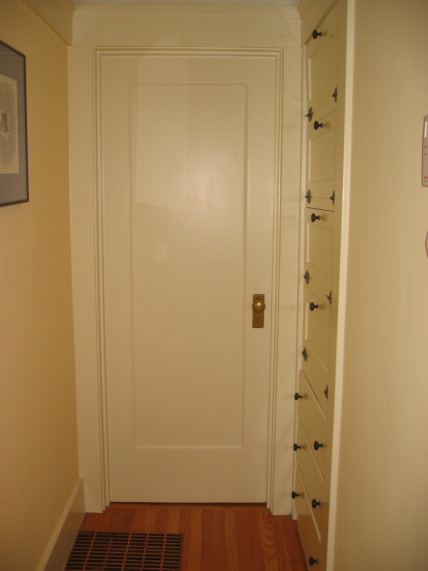 The fourth hallway door, into the second bedroom. | City Homestead