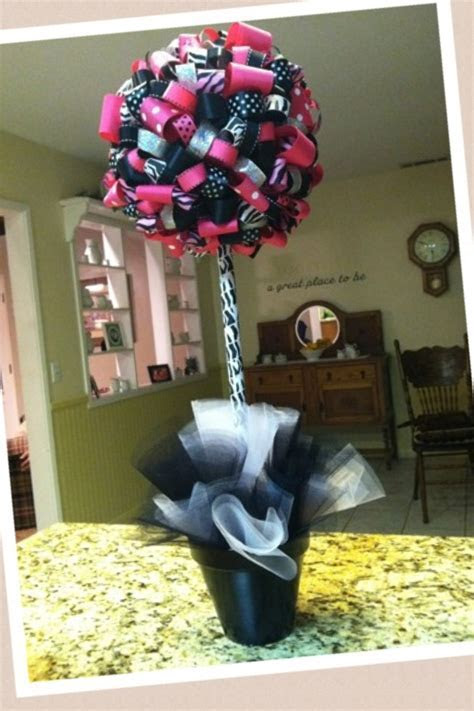 DIY Topiary made out of styrofoam balls and ribbon.   Kids