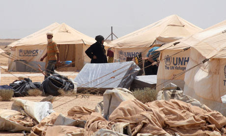 Syrian refugees arrive at the Zaatri refugee camp in Mafraq on the Jordanian-Syrian border