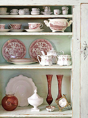 dishes in green shelf