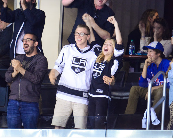 Chloe Grace Moretz Ethan Moretz and Chloe Moretz attend a hockey game between the New York Rangers and the Los Angeles Kings in Game Two of the 2014 NHL Stanley Cup Final at the Staples Center on June 7, 2014 in Los Angeles, California.