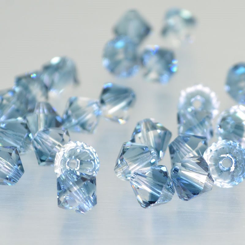2775301s43275 Swarovski Bead - 6 mm Faceted Xilion Bicone (5328) - Crystal/Montana Sapphire Blend (1)
