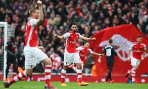 Arsenal celebrate after Alexis Sánchez, centre background, lashed home the Gunners' third goal in the win over Liverpool.