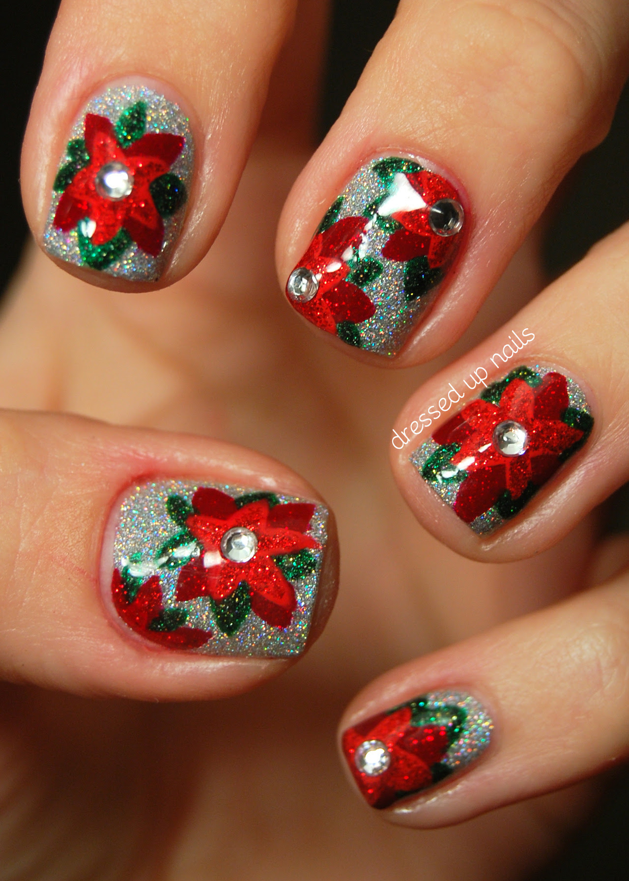 dressedupnails:  Today I have my first holiday nails to show y'all! I just joined a nail art group that posts a week's worth of nails each month relating to a specific theme and this month's theme is (of course) FESTIVENESS! So I hope y'all are ready for five sweet (and GLITTERY) holiday-themed manis this week cuz I'm super pumped to show you them. I did these glittery poinsettia nails a couple weeks ago and it's been hard to wait to post them because I love them a lot… so much that I might re-do them for my actual Christmas nails. You can (AND SHOULD) go check out my blog post for more pictures and an explanation of how I did these! P.S. GLITTER!!! Facebook | Instagram @dressedupnails