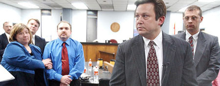 Eric and Cassandra Peoples (left) listen as their attorney discussed their 2004 judgment. (ABC News/AP Photo)