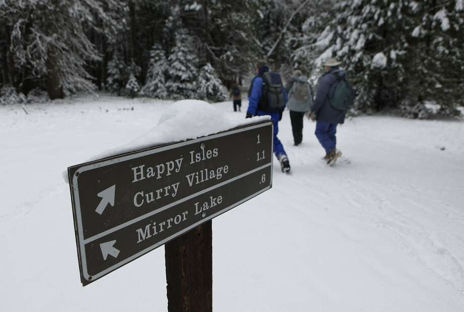 A sign directs Yosemsite visitors to Curry Village, which will become Half Dome Village if the name-rights dispute is not resolved. Photo: Michael Maloney, The Chronicle