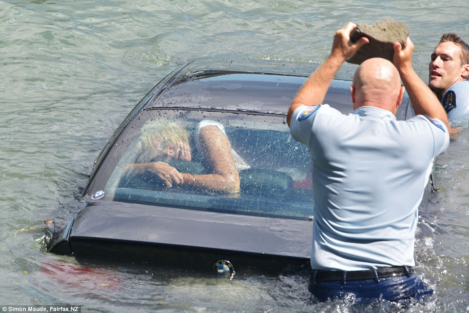 The petrified woman was squashed up against the rear window as the front end of the car was rapdily submerging into the Waitemata Harbour in Auckland, New Zealand, at 3pm on Tuesday