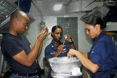 Sailors inspect needles containing influenza v...