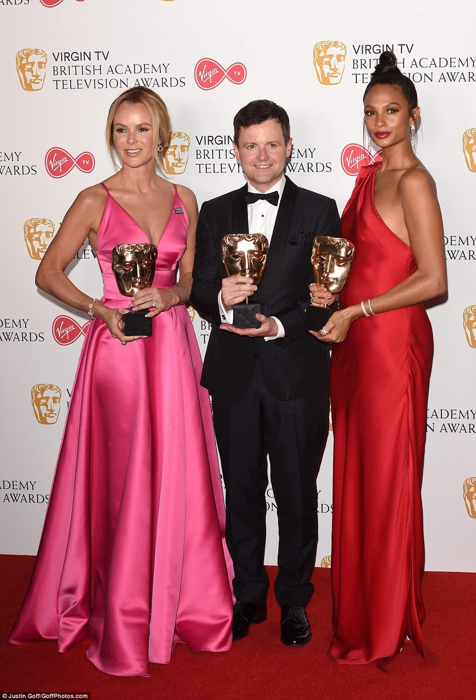 Over the moon: Dezembro juntou-se aos juízes da série ITV Amanda Holden e Alesha Dixon no palco para aceitar o prêmio, mas um dos produtores da série fez o discurso de aceitação