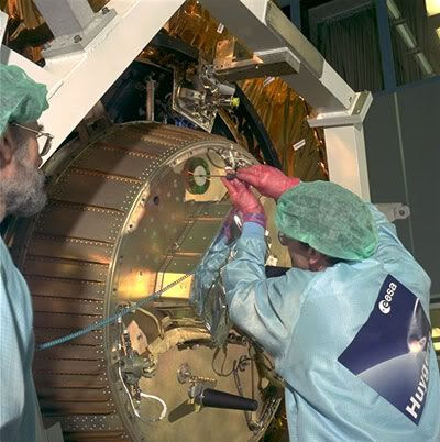 A European Space Agency technician installs a CD bearing the names of 100,000 folks onto the Huygens probe, prior to launch on October 15, 1997.