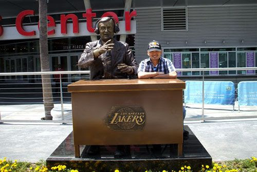 Posing next to a statue of the late Lakers broadcaster Chick Hearn at STAPLES Center on June 19, 2010.