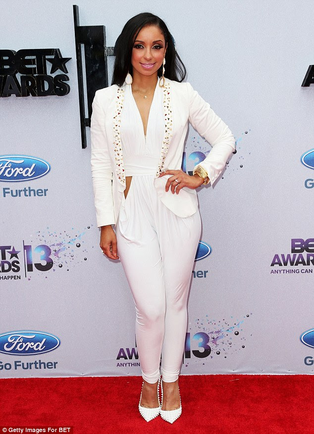 Star-studded affair: Mya mixed up her look with a menswear inspired jumpsuit