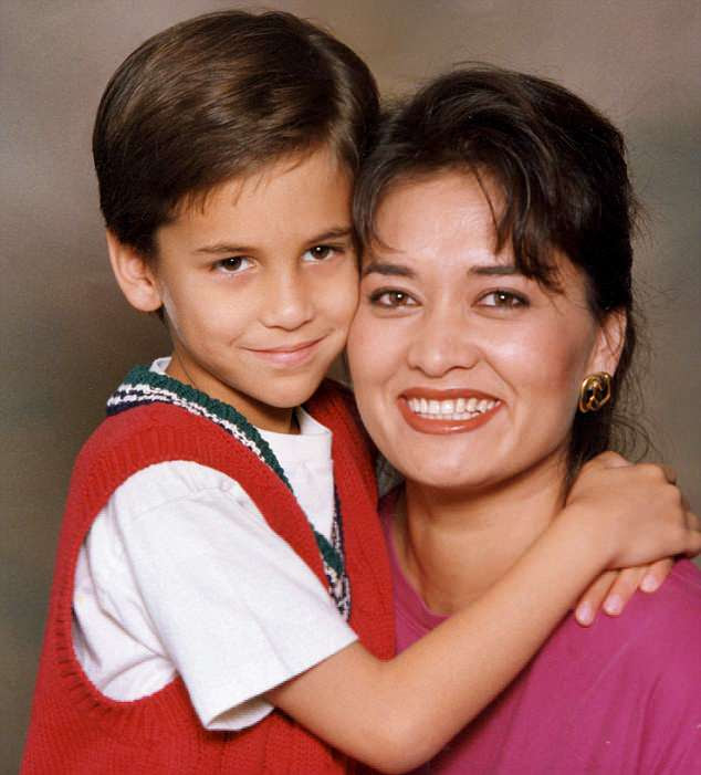 Jonathan is pictured as a child with his mother Katherine Berkery