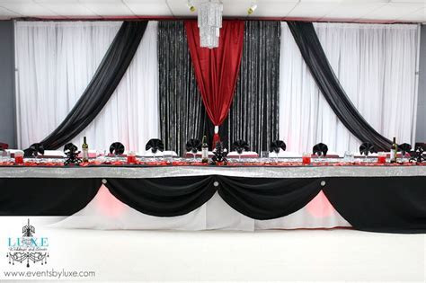 Red and black Backdrop decor from LUXE weddings and events