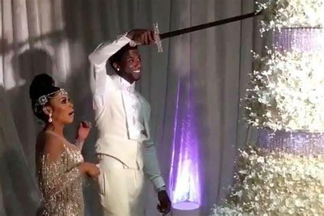 Watch Gucci Mane Cut His $75,000 Wedding Cake With a Sword