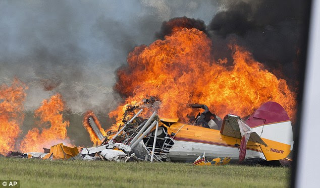 Smoke: A stunt plane is consumed by fire after crashing at the Vectren Air Show in Dayton, Ohio. The crash killed two, the pilot and winger walker Jane Wicker