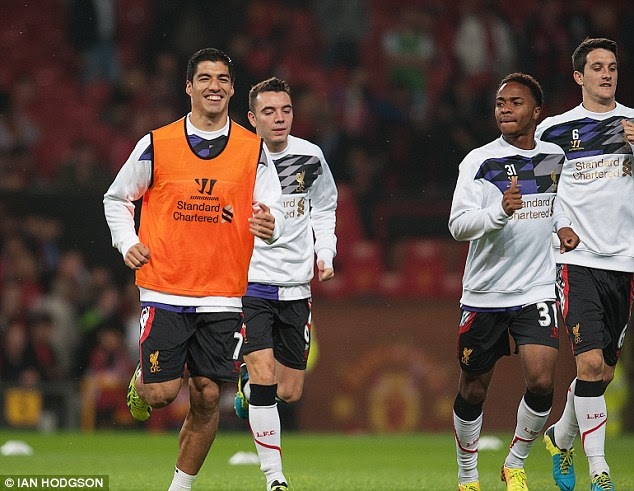 Look who's back: Luis Suarez looked happy to be in the Liverpool side again as he warmed up for the match