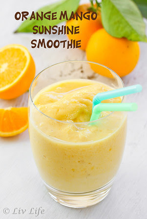 Orange Mango Smoothie with oranges in background