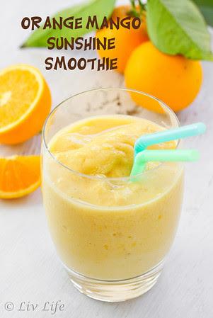 Orange Mango Smoothie with oranges in background