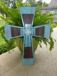 Decorated Wooden Cross on stand covered in clear stones with metal fl…