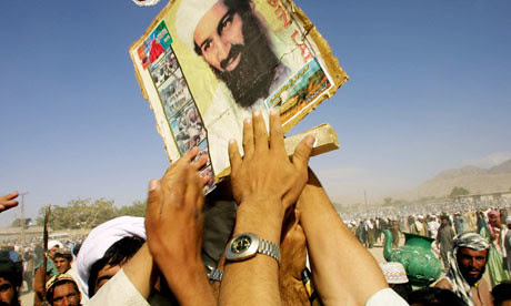 Rally in Central Asia where the photograph of Osama bin Laden is held up by participants. A Taliban commander says that the announced death of Bin Laden will be avenged. by Pan-African News Wire File Photos