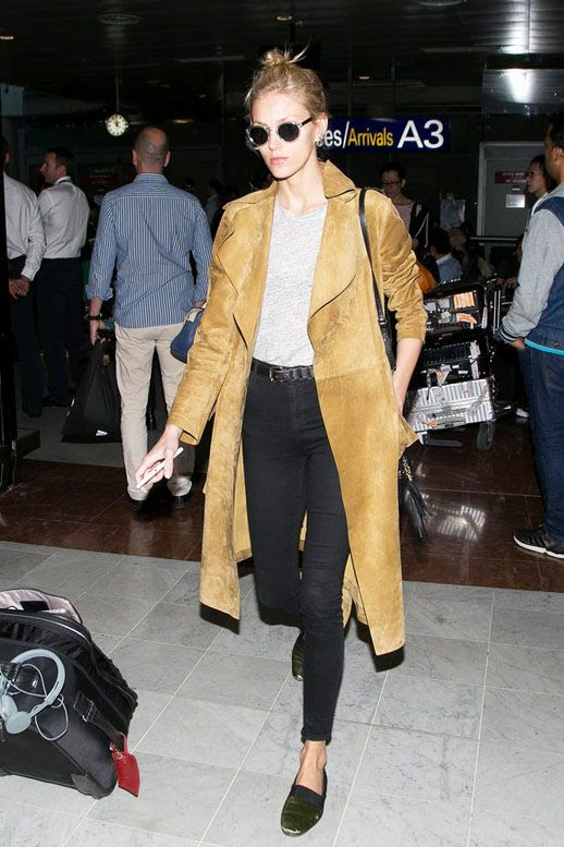 Le Fashion Blog Airport Style Model Off Duty Anja Rubik Top Knot Round Sunglasses Brown Long Suede Trench Coat Grey Tee High Waisted Black Skinny Jeans Flats Via Vogue