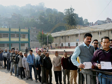 File image of voters at a polling booth in Mandi, Himachal Pradesh. PTI