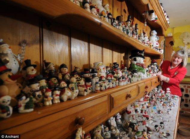 A collection that would surely make Scrooge smile: Despite the remarkably efficient arrangement of the snowmen, the glittery gathering began purely by accident back in 1987