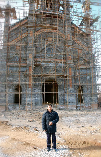 Fr. Zhang in front of his new church at Zhujiahe Village.