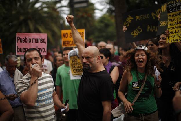 Demonstrators shout slogans during a demonstration in Malaga