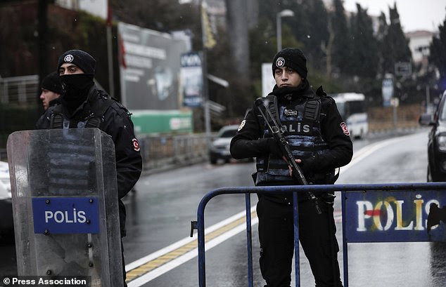 Turkish police officers block the road leading to the scene of an attack in Istanbul
