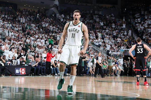 b82aec7b589268 Brook Lopez outduels Kyle Lowry to deliver wild Game 1 win for the Bucks