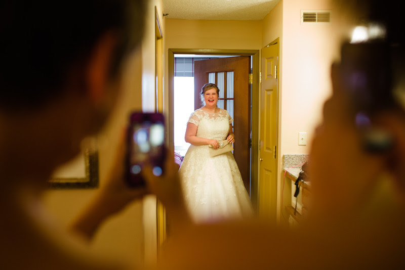 The Bride gets ready with her Man of Honor and Bridesmaids at the Country Inn and Suites in Sycamore IL for her wedding at Blumen Gardens.