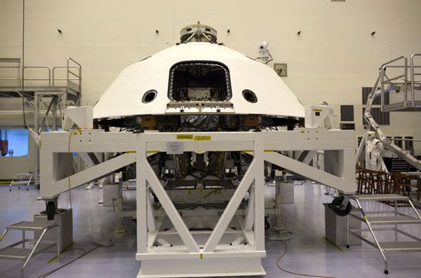 The Curiosity Mars rover and its descent stage are enclosed by the backshell at NASA's Kennedy Space Center in Florida.