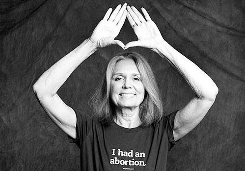 "This Gloria Steinem pic is not new (it came out before this site existed) but it is worth mentioning. It features her wearing a shirt saying ""I had an abortion"" while giving an Illuminati hand sign above her head. That goes right into the elite's depopulation Agenda combined with the complete devaluation of the sacredness of motherhood."