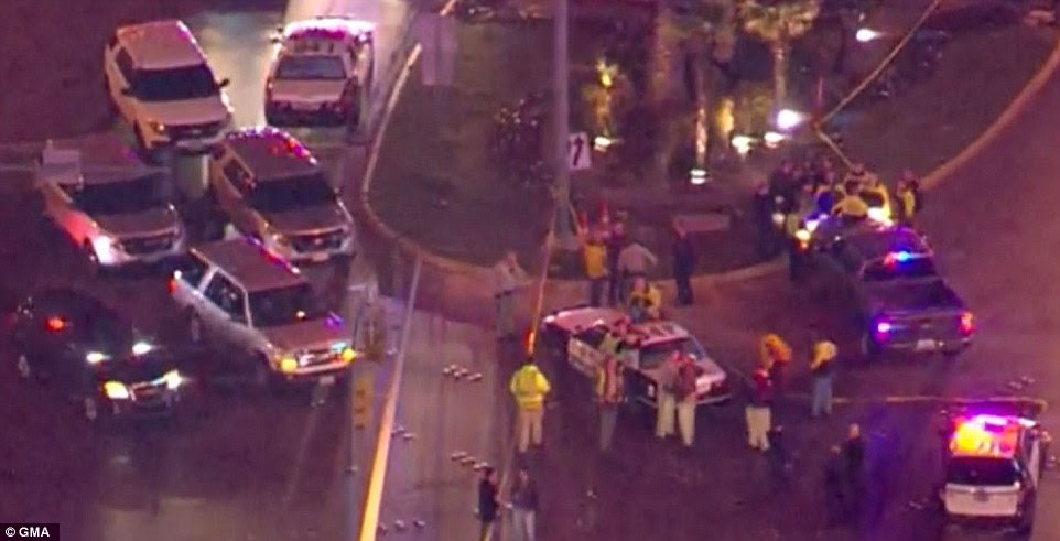 An aerial shot over the area shows the aftermath of a crash that left one person dead, six critical and 31 others injured