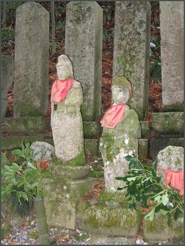 28 stone Buddhas and moss