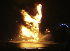 "Flames shot up from the ""King of King's"" statue of Jesus Christ early Tuesday morning after it was struck by lightning."