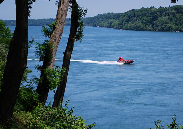 One of the Whirlpool Jet Boats heading up the Niagara River from Niagara-on-the-Lake