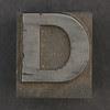 Caslon metal type letter D
