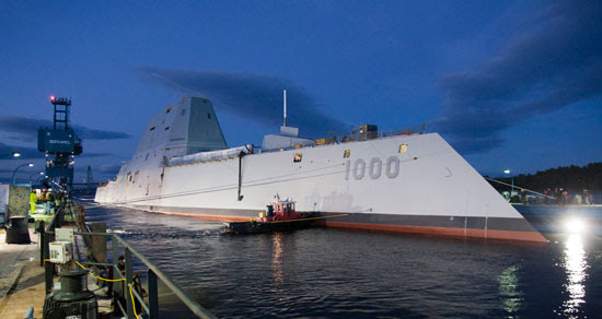 The Zumwalt-class guided-missile destroyer DDG 1000 is floated out of dry dock at the General Dynamics Bath Iron Works shipyard. The ship, the first of three Zumwalt-class destroyers, will provide independent forward presence and deterrence, support special operations forces and operate as part of joint and combined expeditionary forces. Photo: General Dynamics