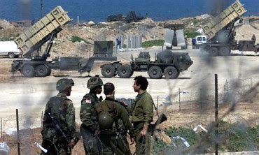 Israeli, US soldiers near Patriot missiles