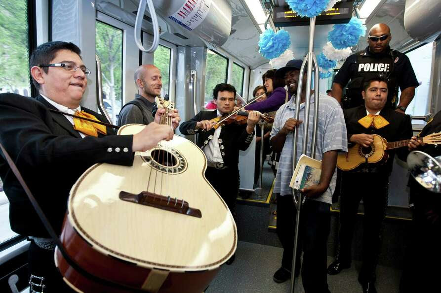 Edgar Casares, a guitar on player with Mariachi Calmecac, plays with his grupo during METRORail's 10