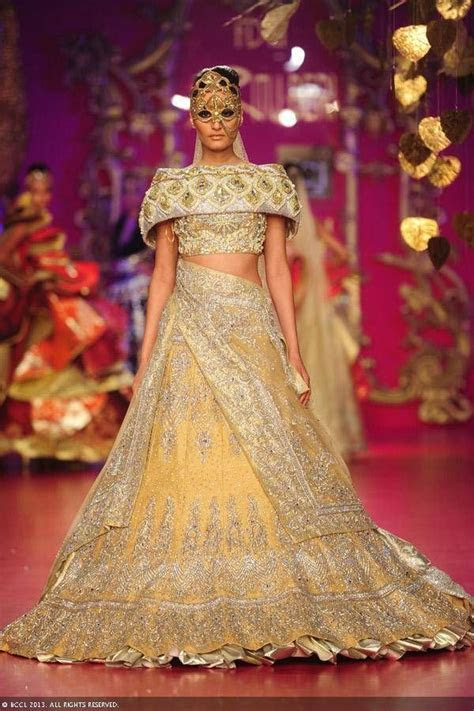 Gold and yellow lengha by Ritu Beri at Delhi Couture Week
