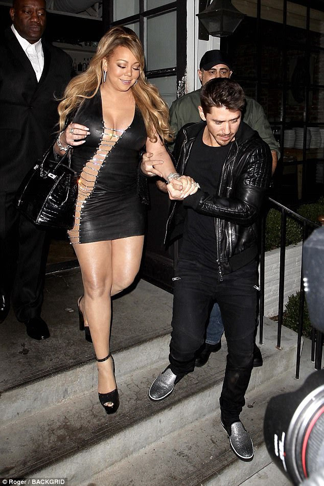 Teetering: The Vision of Love singer struggled to keep her balance in towering platform heeled sandals, so Tanaka gave her a very solid arm to count on, as she headed down stairs