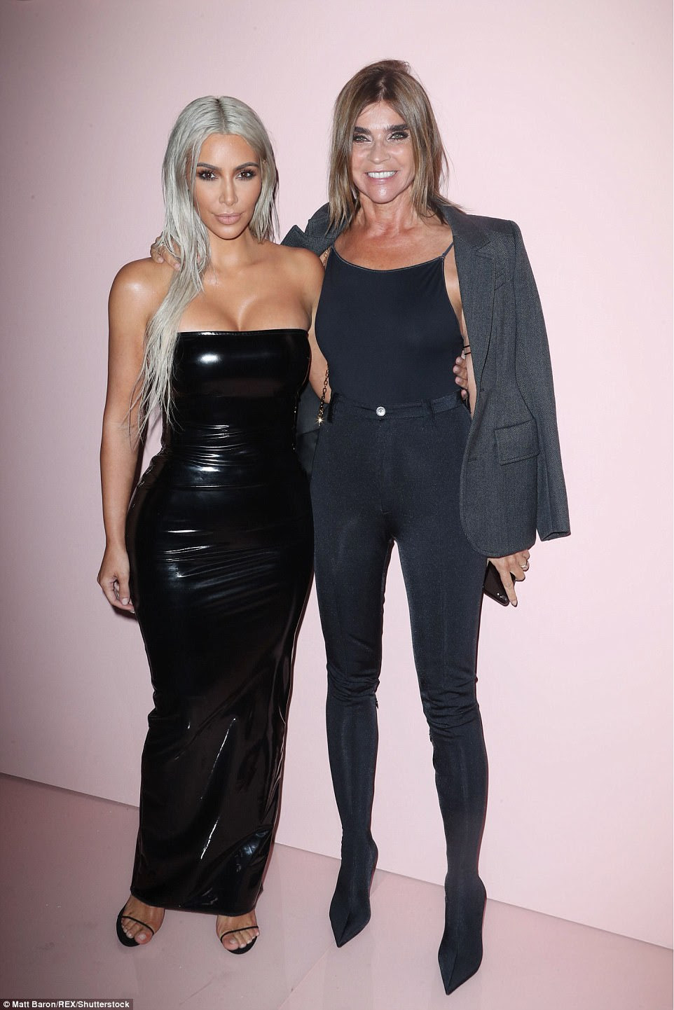 Strike a pose: Before heading to her seat, Kim stopped to take a picture with Carine Roitfeld, the founder and editor-in-chief of CR Fashion Book