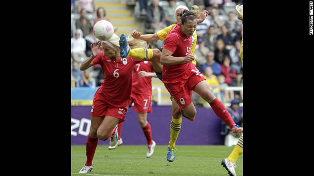 Canada's Melissa Tancredi, right, heads the ball to score her team's second goal against Sweden in Newcastle-upon-Tyne.