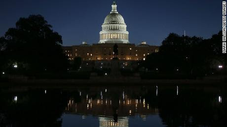 131015213528-capitol-night-reflected-gi-